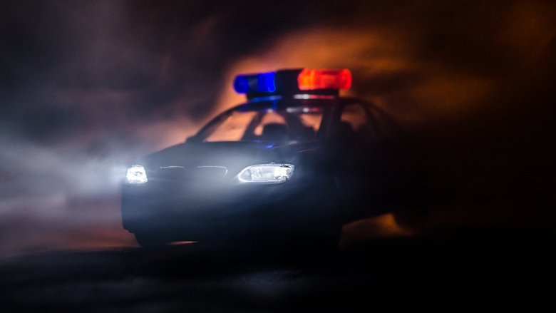 Police cruiser in fog