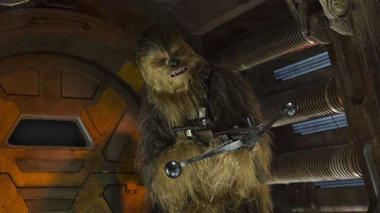 Chewbacca with his bowcaster in The Force Awakens