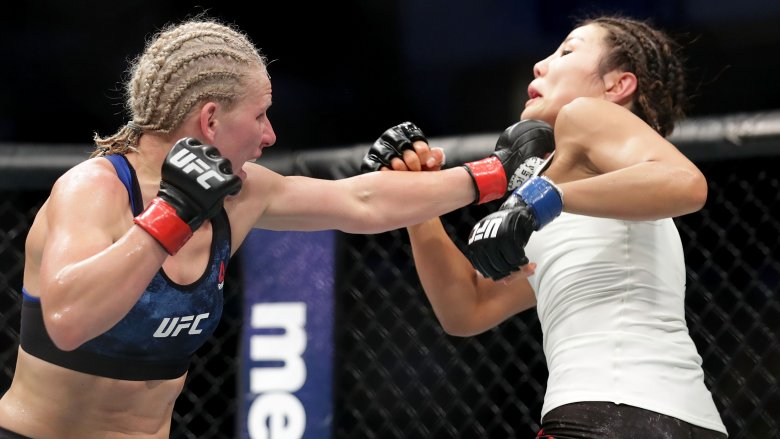 UFC fighter Justine Kish grabs opponent