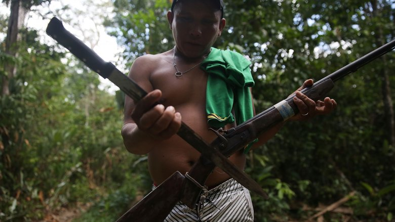 indigenous man in jungle