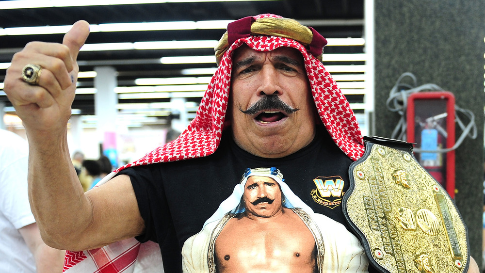 The Iron Sheik with a championship belt