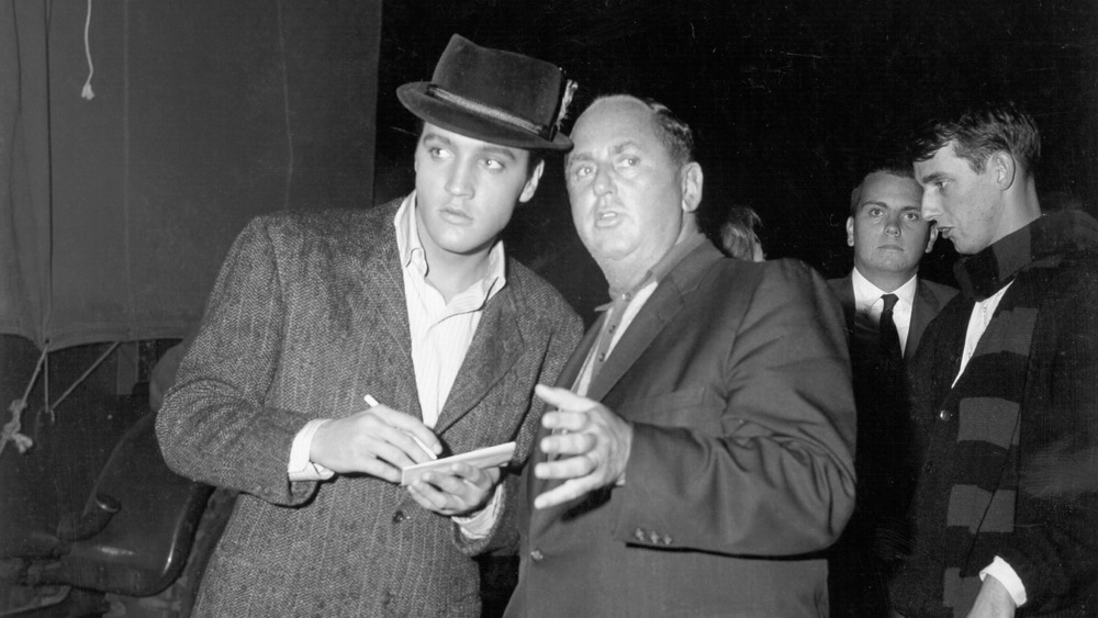 Elvis Presley and Colonel Tom Parker in 1957