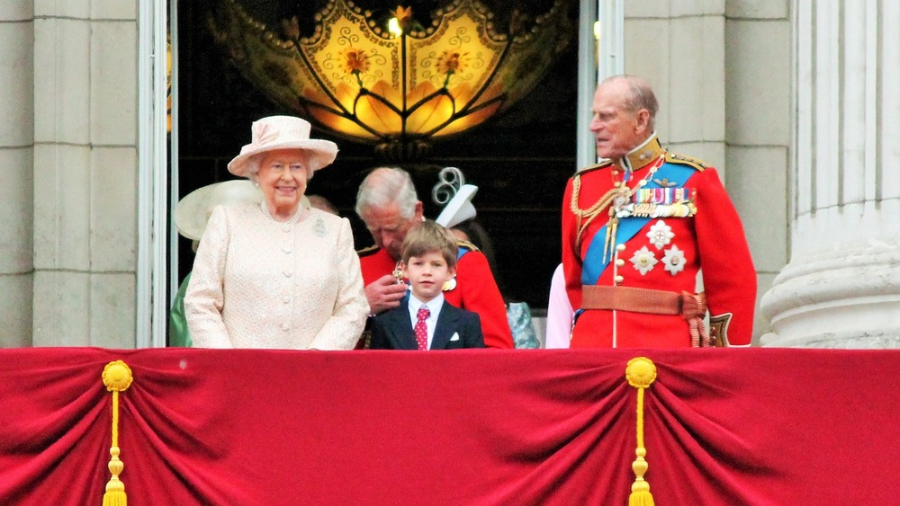 Queen Elizabeth, Prince Charles, Prince Philip, and some kid