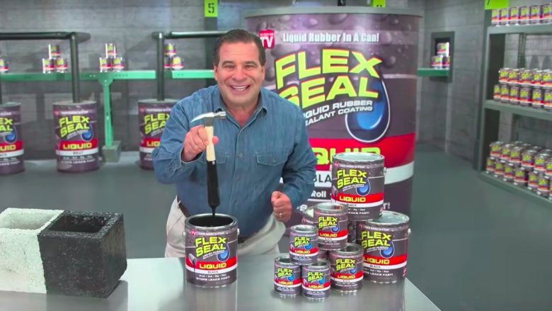 Phil Swift with cans of Flex Seal