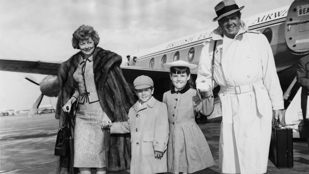 Lucille Ball Desi Arnaz with children getting off of plane