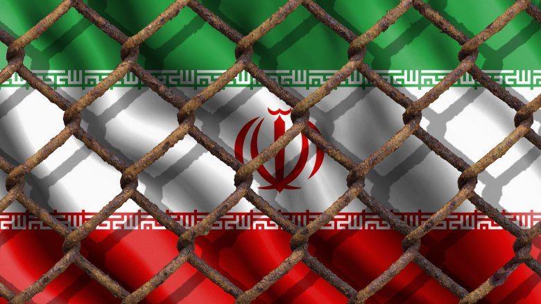 Iranian flag behind a fence