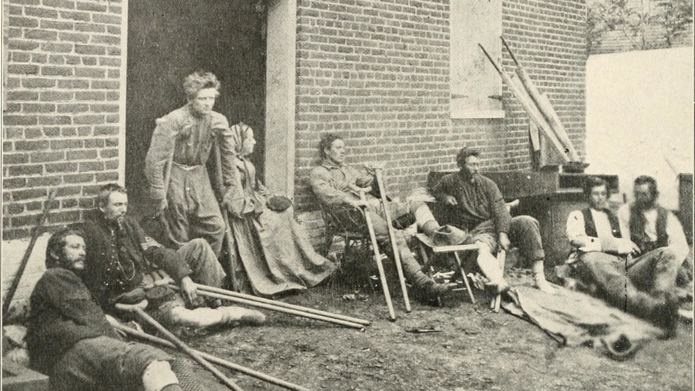 A nurse and wounded Union soldiers outside